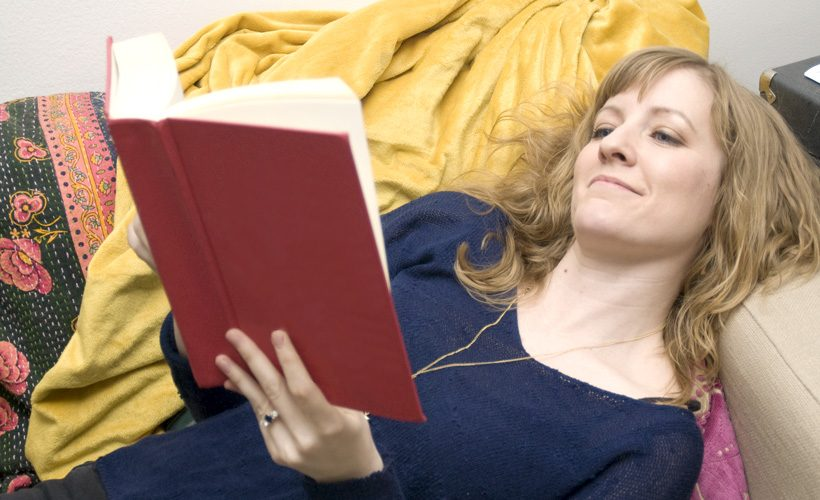 woman reading blank book