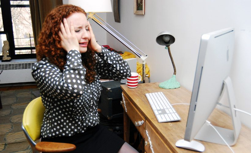 woman crying at desk