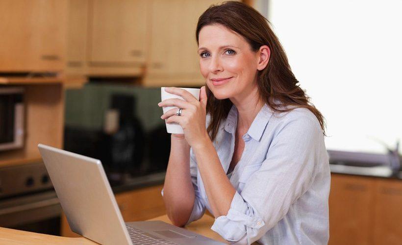 woman computer coffee