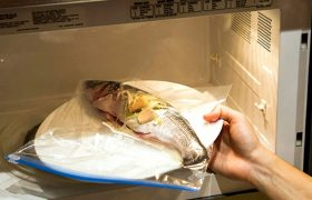 Woman Continues to Microwave Fish at Work