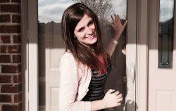 smiling woman by door
