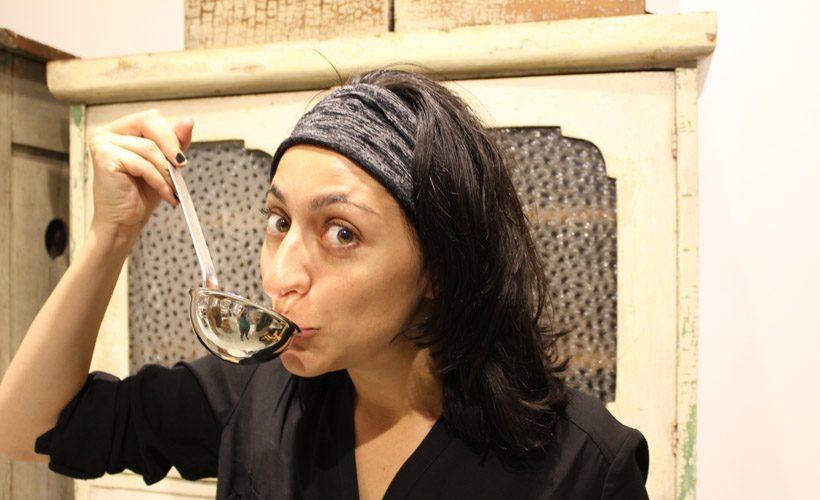 Woman cooking soup kitchen