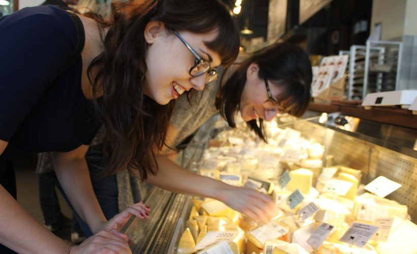 Woman friends food cheese shopping