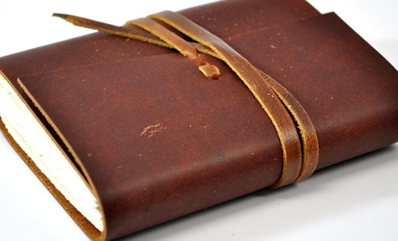 2 hand sewn leather notebook