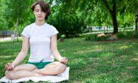 woman calm meditate outside