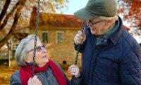 old-people- couple swings outdoors