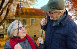 old-people- couple swings outdoors