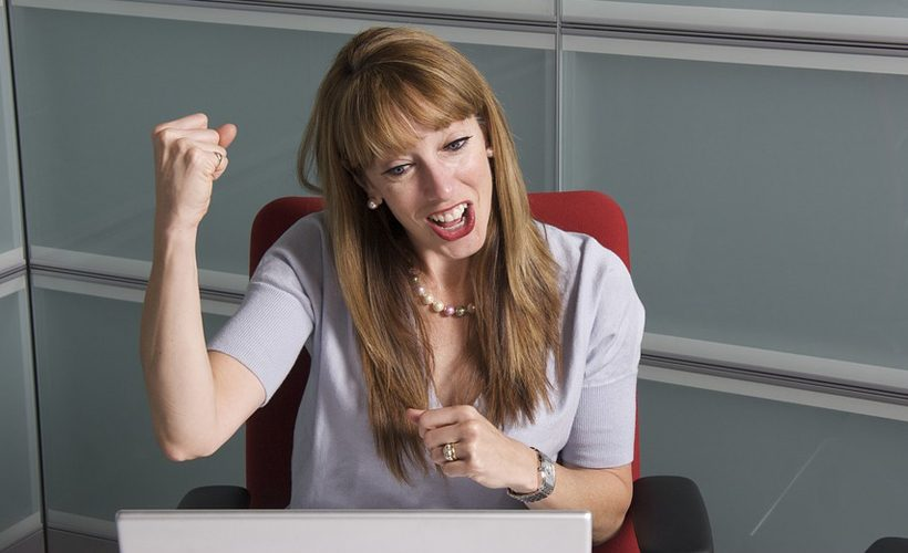 woman excited office computer