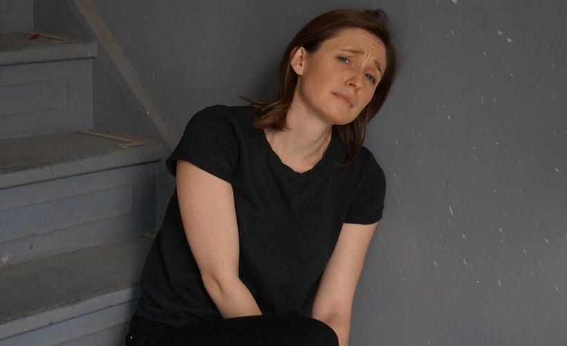 woman sad stairs