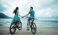 couple beach bike date ocean