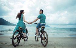 couple beach bike date ocean