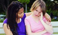 teenage girl consoling her sad upset friend