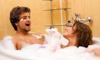 Beautiful young couple enjoying a foamy bath