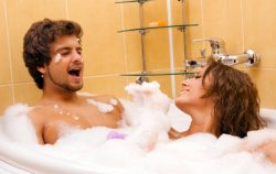 Beautiful young couple enjoying a foamy bath