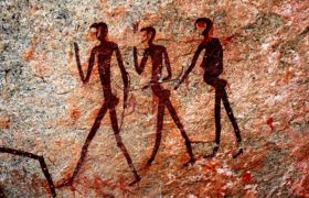 Cave Painting Shows Woman Moving Pile of Clothes From Bed Rock to Floor Rock