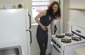 Woman Inexplicably Cleans Her Stove Before Casual Hookup Arrives