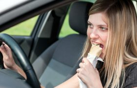 5 Subtle Ways Your Body Language Could be Revealing You Just Scarfed a Giant Burrito in Your Car