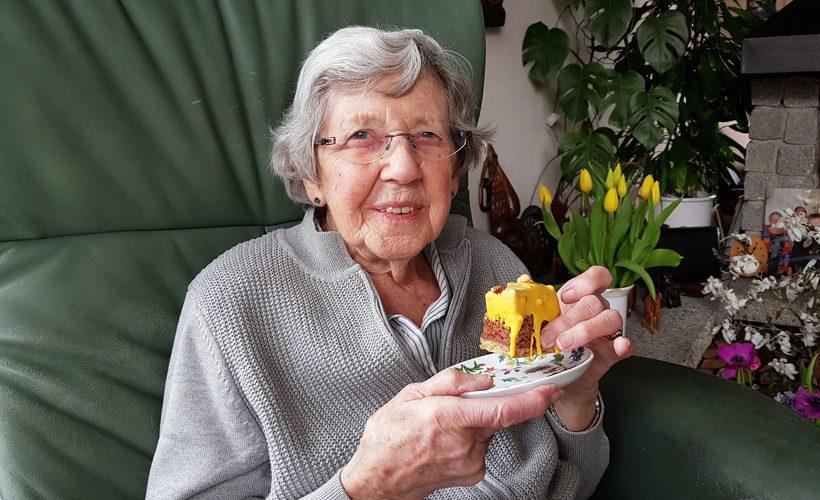 grandma eating cake old woman