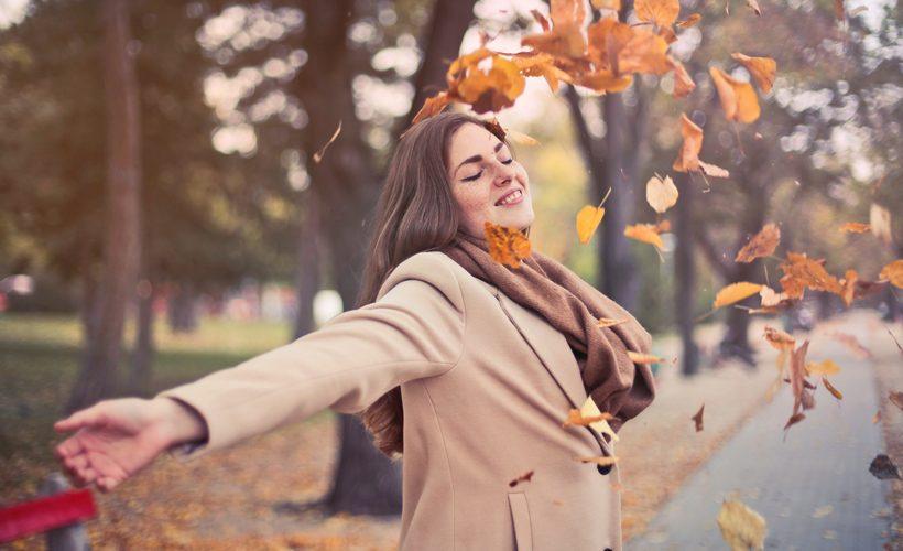 woman fall leaves