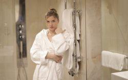 women in bathrobe outside shower