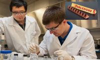 scientists in a lab, picture of toblerone in corner