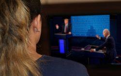 woman watching presidential debates