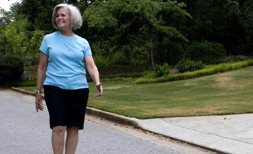 Older woman walking alone