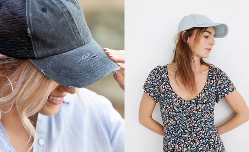 two girls side by side wearing baseball hats