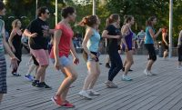 people line dancing outside