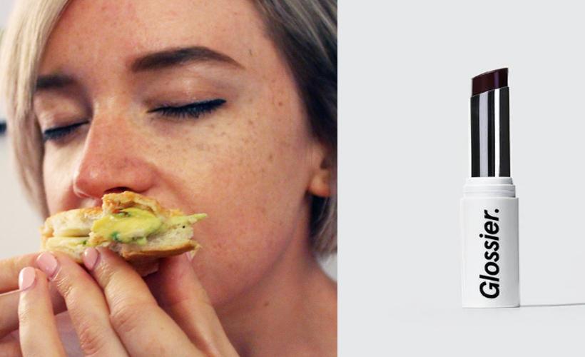 woman eating sandwich next lipstick