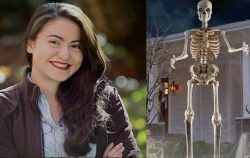 woman proud next to 12 foot home depot skeleton