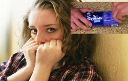 scared woman with pillsbury can being opened in corner