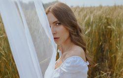 woman mysterious behind a sheet