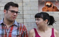 couple talking muppets picture in corner