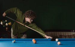 man playing pool billiards